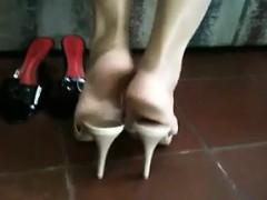 Latina Putting On Her White High Heels