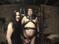 fat-dude-is-tied-up-and-she-uses-an-iron-to-whack-him-in-th