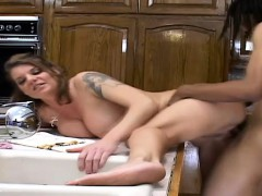 stacked-blonde-cougar-feeds-her-hunger-for-black-meat-in-the-kitchen