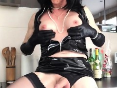 horny-shemale-dressed-in-black-latex-takes-out-her-bulging