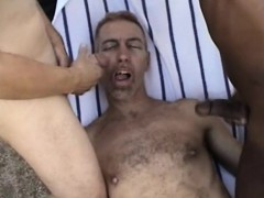 charming-guy-has-two-hung-studs-filling-his-mouth-with-their-juices