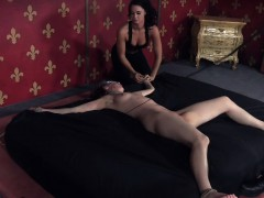 Gagged Sub Restrained To A Bed And Whipped