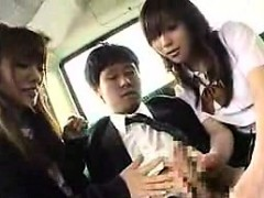 Two Attractive Japanese Schoolgirls Work Their Hands On A S