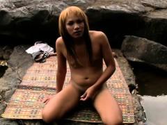 chubby-asian-teen-ts-masturbates-tiny-girl-rod-in-the-river