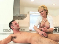 lady-sonia-jerks-off-young-stud-on-kitchen-counter