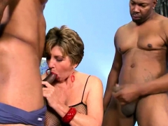 Busty grandma fucked by two black guys