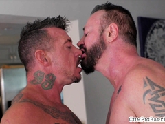 Tattooed Wolf Gets Barebacked By Stud
