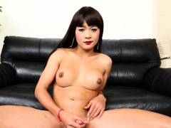Naughty asian ladyboy fondling her cock