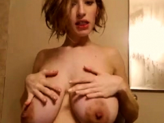 busty-girl-squeezes-hard-nipples-in-the-kitchen