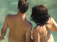 horny couple have sex by the ocean nudist beach
