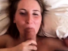 Blonde slut with perky titties giving blowjob to two cocks