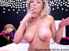 hot blonde with massive boobs solo Striptease