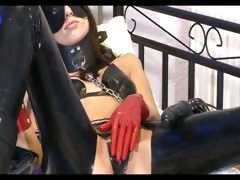 tied up slut fingers herself on bed