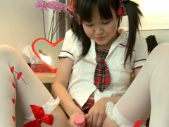 nipponese-babe-is-playing-with-her-soaking-wet-box