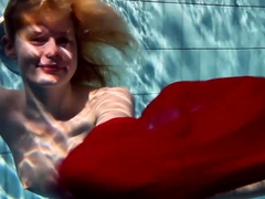 Russian teenie Lucie goes underwater swimming
