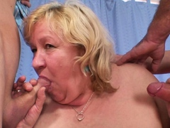 Busty hairy granny swallows two cocks before DP