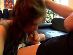 Redhead young cutie giving blowjob