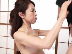 japanese-milf-enjoys-an-oily-massage-and-fingering