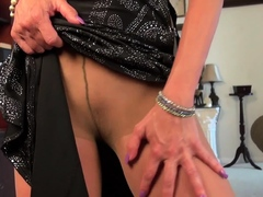 Mature Mimi uses massage oil on her nyloned pussy