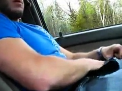 Guy strokes himself in the car while he waits for his buddy