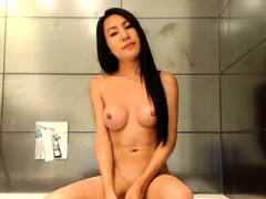 Solo ladyboy jerking cock before cumshot