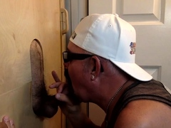 Gloryhole hunk eagerly gobbles dick
