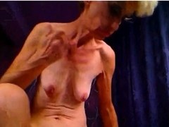 UGLY GRANNY POSES FOR CAM AND POKES ASS